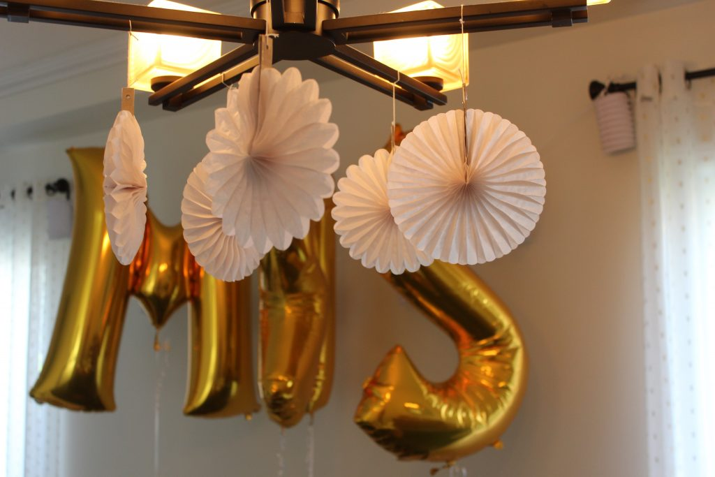 Create a fun selfie wall for guests with foil balloons, hanging paper lanterns, and a little bit of fun for everyone!