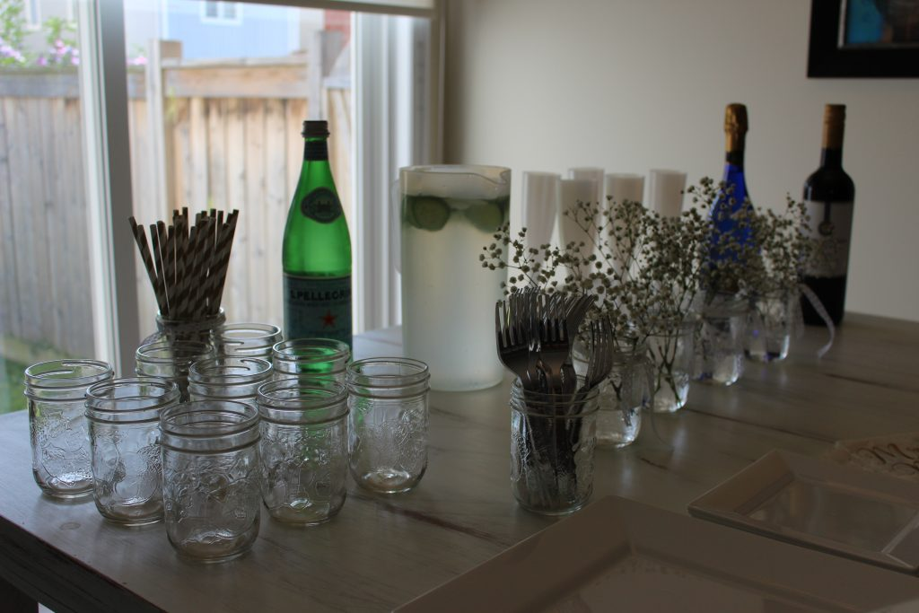 Set up a drink bar for people to help themselves - include paper straws, champagne, wine, lemonaid, cucumber water, and something sparkling so everyone has something they'll like.