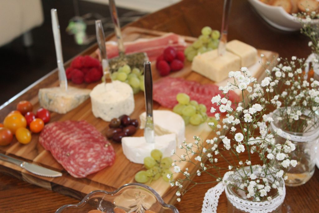 A cheese board is the perfect food offering for a shower - combine meats and cheese so there's a little something for everyone! Serve a variety of finger foods so that guests of the bridal shower can snack and chat throughout the afternoon.