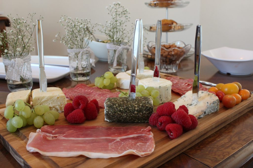 A Charcuterie Board is the perfect food offering for a shower - combine meats and cheese so there's a little something for everyone! Serve a variety of finger foods so that guests of the bridal shower can snack and chat throughout the afternoon.